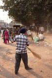 Indian man cleaning street after Guru Nanak Gurpurab celebration Royalty Free Stock Photo