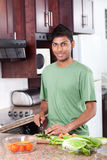 Indian man cooking Stock Image