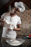 Indian man cooking dinner Stock Images