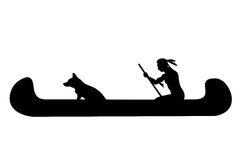 Indian man and dog in canoe. Silhouette of indian man and dog in canoe Royalty Free Stock Images