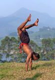 Indian man doing handstand exercise outdoors Stock Images