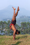 Indian man doing handstand outdoors Royalty Free Stock Image