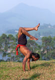 Indian man doing handstand outdoors in Kerala, South India Stock Photos