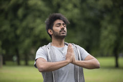 Indian man doing yoga exercise in a park Royalty Free Stock Image