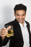 Indian man with a drink Stock Images