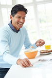 Indian Man Enjoying Breakfast At Home royalty free stock photo