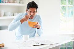 Indian Man Enjoying Breakfast At Home Royalty Free Stock Photography