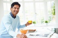 Indian Man Enjoying Breakfast At Home Royalty Free Stock Photos
