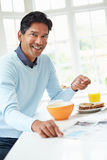Indian Man Enjoying Breakfast At Home Stock Photography