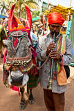 Indian man with flute and donkey Royalty Free Stock Photography