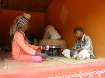 Indian man fortune-teller parrott  statue Stock Image