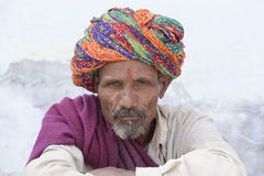 Indian man on the ghat along the sacred Sarovar lake in Pushkar, India Stock Photo