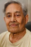 Indian man gray hair. Head only portrait of an Indian senior man with gray hair Stock Photography