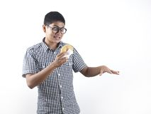 Indian Man Happy with his pastry Stock Image
