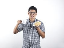 Indian Man holding Asian Pastry and cup Royalty Free Stock Image