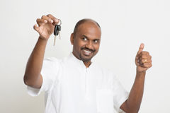 Indian man holding car key and thumb up Stock Photos