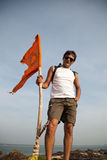 Indian man holding hindu flag Stock Images
