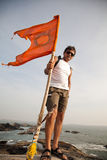 Indian man holding hindu flag Royalty Free Stock Image