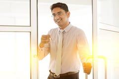 Indian man holding office key stock photos