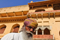 Indian Man. JAIPUR, INDIA, MARCH 3: An unidentified man in Agra Fort on March 3, 2012 in Jaipur, Rajasthan, Northern India. Amber Fort overlooks Maota Lake and Stock Photography