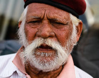 Indian Man. JAIPUR, INDIA, MARCH 4: An unidentified man outside the City Palace on March 4, 2012 ahead of the annual Holi Festival in Jaipur, Rajasthan, Northern Stock Images