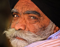 Indian Man. JAIPUR, INDIA, MARCH 4: An unidentified man outside the City Palace on March 4, 2012 ahead of the annual Holi Festival in Jaipur, Rajasthan, Northern Royalty Free Stock Photos