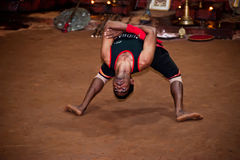 Indian man, Kalaripayattu master performing traditional ancient martial art. India, Kerala Royalty Free Stock Images