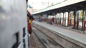 Indian man looking peeking out the window during a train ride. stock footage