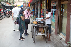 Indian man is making street food near the New Market, Kolkata, India Royalty Free Stock Image