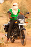 Indian man on Motorbike Royalty Free Stock Image
