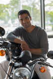 Indian man on motorbike Royalty Free Stock Photography