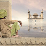 Indian man. Indian man near a palace in the Ganges Stock Image