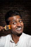 Indian man with paintbrush Royalty Free Stock Photo