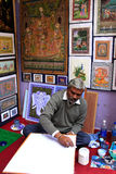 Indian man painting, Udaipur, India Stock Photo