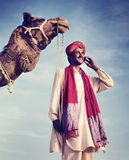 Indian Man On the Phone Camel Communication Concept Stock Image