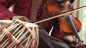 Indian man play music on Violin stock footage