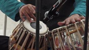 Indian man playing Indian music on Tabla Punjabi drums stock video