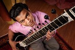 Indian Man Plays a Sitar Royalty Free Stock Photos