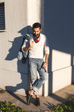 Indian man posing in an urban context. Stock Photos
