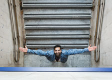 Indian man posing in an urban context. Stock Photo