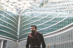 Indian man posing in an urban context. Royalty Free Stock Images