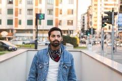 Indian man posing in an urban context. Royalty Free Stock Image