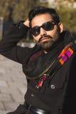 Indian man posing in an urban context. Stock Images