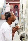 Indian man praying.Bikaner-INDIA Royalty Free Stock Photo
