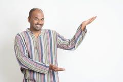 Indian man presenting Stock Image