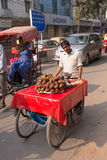 Indian man pushing cart with food in the busy street of Delhi, I Royalty Free Stock Photo