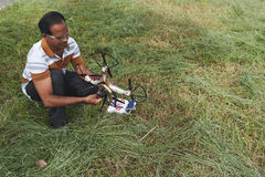 Indian man with quadcopter Royalty Free Stock Photo