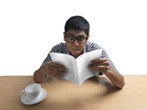 Indian Man reading book amazed Stock Images