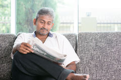Indian man reading newspaper Royalty Free Stock Image