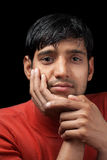 Indian man relaxed and thinking Royalty Free Stock Image